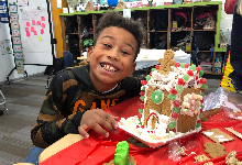 Third graders are making gingerbread houses