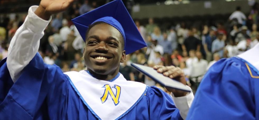 NWHS graduate waving