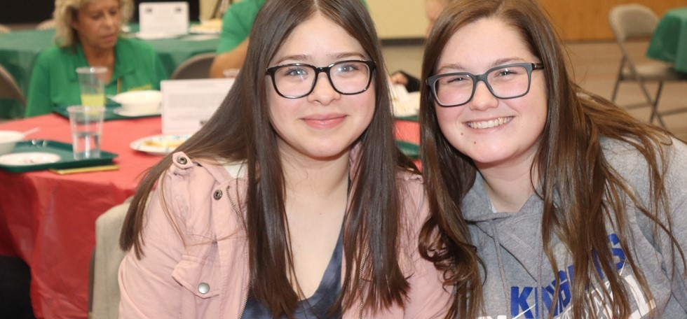 Two female PRMS students at the PTA Bowls event