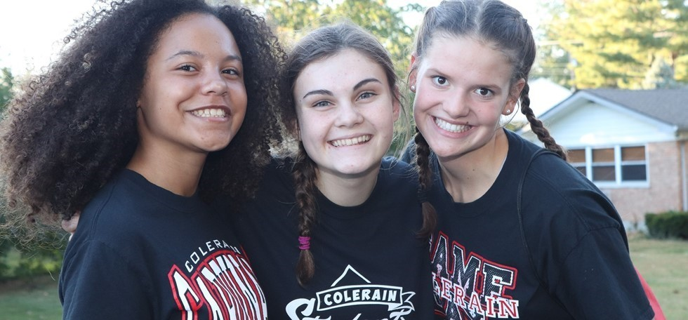 Three female Colerain High School Students at a pep rally