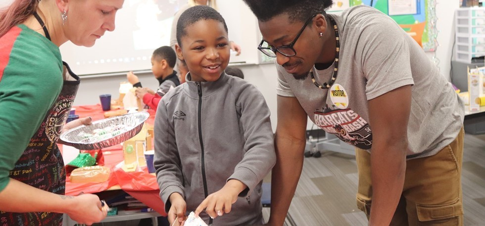 Struble Elementary student doing a hands on project with a visiting parent